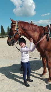 Castrone Quarter Horse Tabasco Jac Jetn con bambina